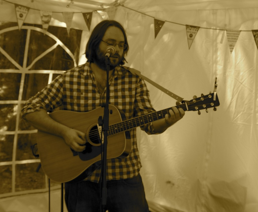 Rob playing guitar at Chorleywood Village Day 2013