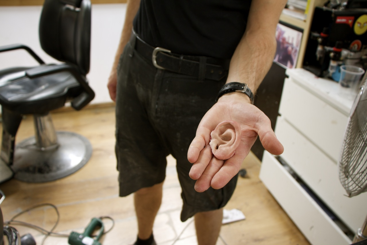 prosthetic ear being held in a hand