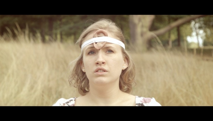 Girl with severed ear attached to forehead, Rob Finlay music video fro the track Call Back the Day