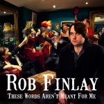 Rob Finlay sitting in a room at a masquerade