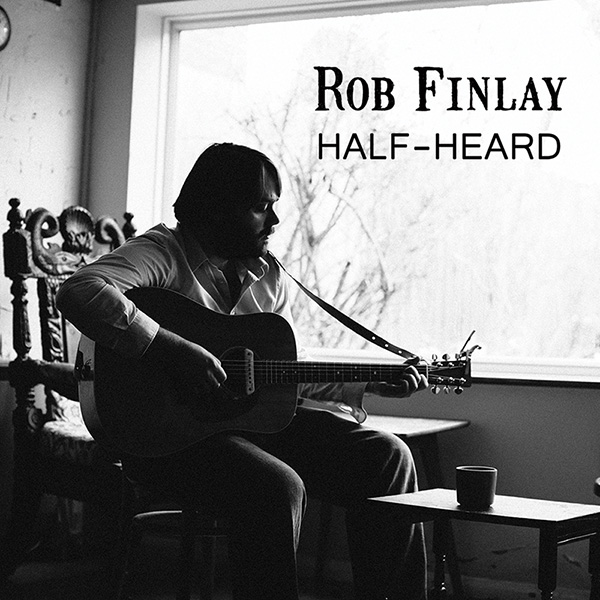 Black and white shot of Rob Finlay playing guitar